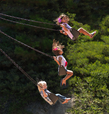 Children playing on swings at park