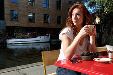 Woman drinking cup of coffee outdoors