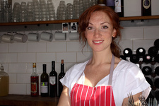 Woman in apron working at cafe