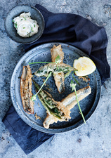 Plate of fried fish with lemon