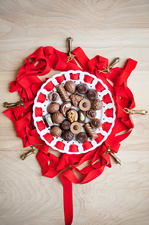 Plate of chocolates with red ribbon