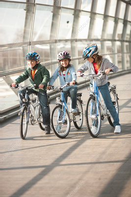 Children riding bicycles in city tunnel