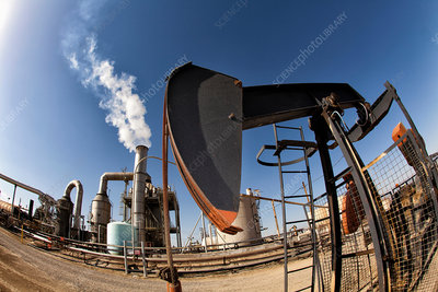 Oil pump and smoke stack in oil field