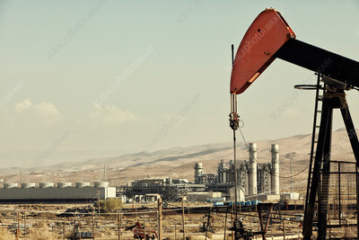Oil pump and refinery in oil field