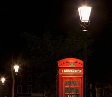 Red telephone box on city street