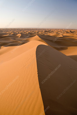 Shadows on sand dunes in desert