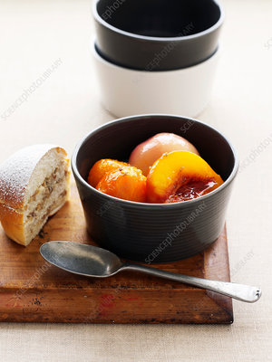 Cup of stewed fruit with cake