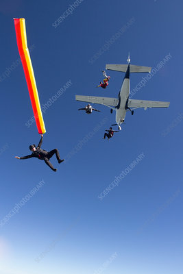 People skydiving from plane