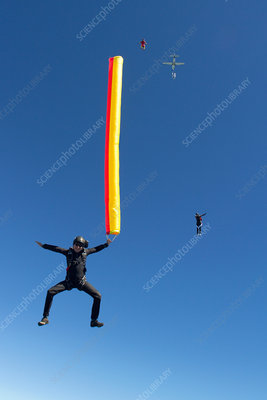 Woman skydiving with parachute
