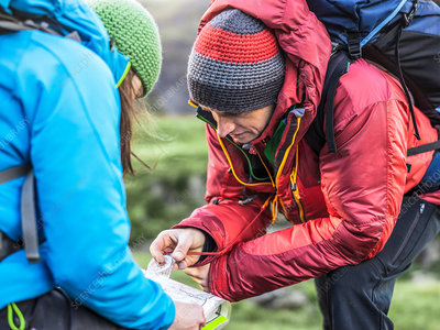 Hikers using map and compass
