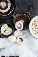 Pots of mushrooms with muslin