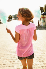 Woman having cotton candy outdoors