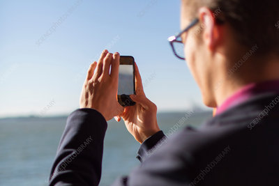 Businessman taking cell phone picture