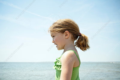 Smiling girl standing on beach