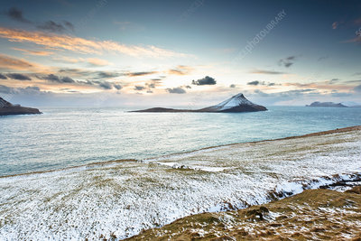 Ocean and snowy rural landscape
