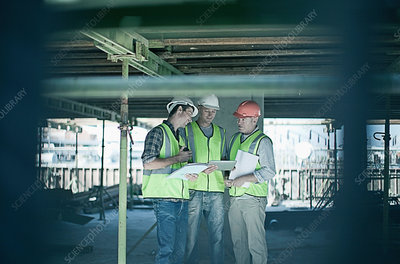 Construction workers talking on site