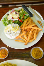Plate of fries, dinner salad and eggs