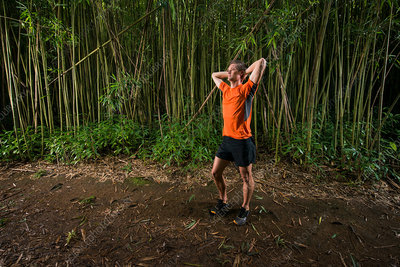 Runner standing in bamboo forest