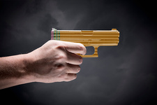 Person holding handgun made with pencils