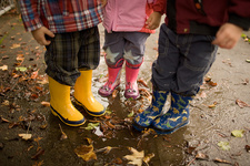 Three children wearing wellington boots