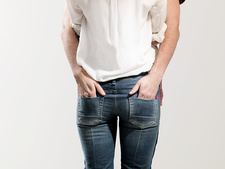 Man's hands in woman's pockets, studio shot