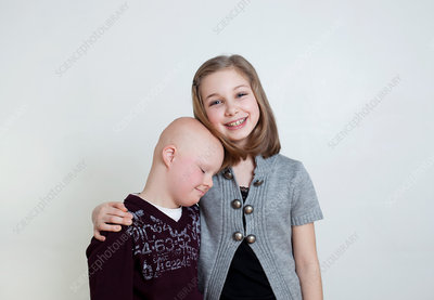 Sister brother with Down's Syndrome, studio shot