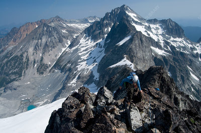 Female climber on mountain summit, WA, USA