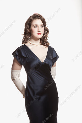 Woman in 1920's style dress against white background