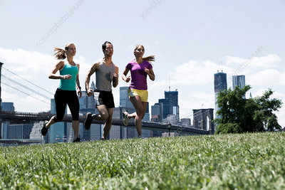 Three people jogging in park