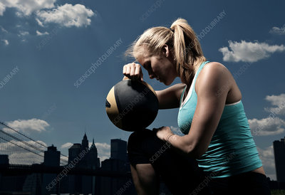 Woman resting with ball