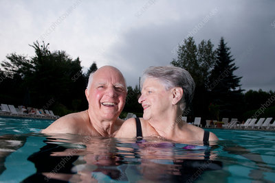 Senior couple in swimming pool