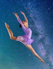 Ballerina leaping against starry night sky