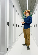 One employee standing in data storage room