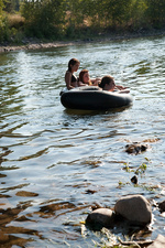 Ladies cruising river in rubber floats