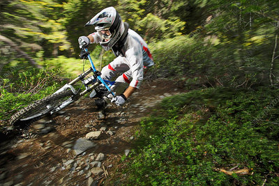 Mountain biker speeding on forest track