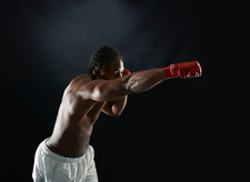 Young male boxer punching