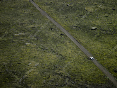 Aerial view of lone car on gravel road to Dyrholaey, Iceland