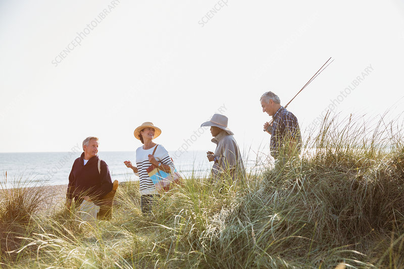 Senior couples with fishing pole walking