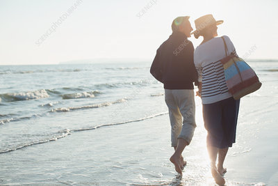 Barefoot mature couple walking