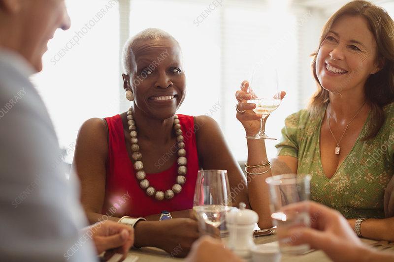 Mature friends dining