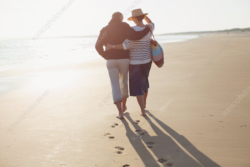 Mature couple hugging and walking