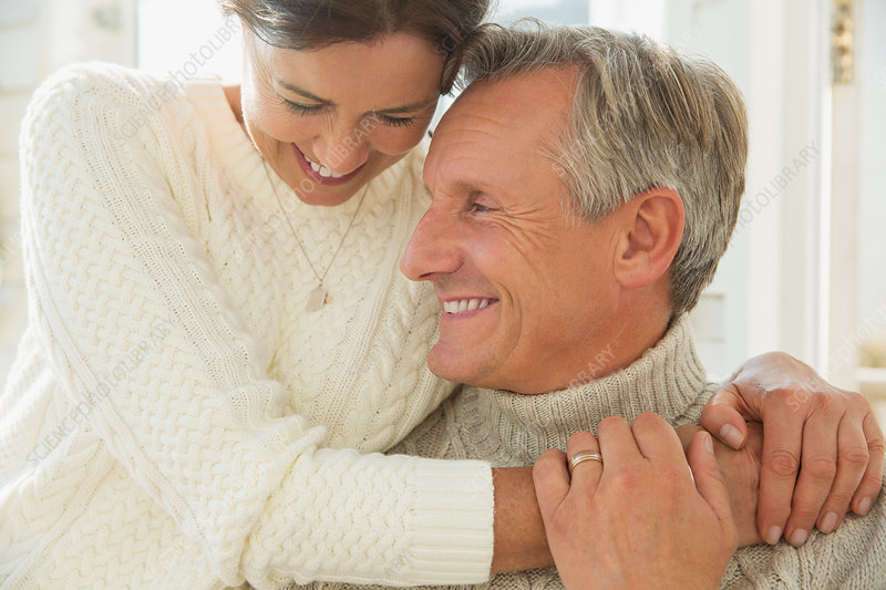 Close up mature couple hugging and