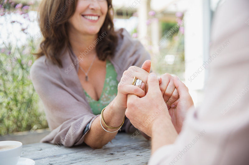 Close up mature couple holding hands