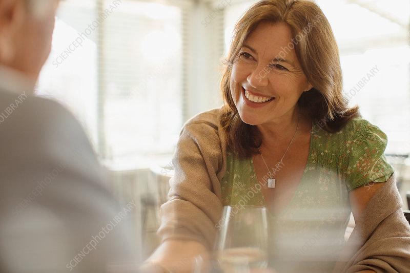 Smiling mature woman enjoying date, dining