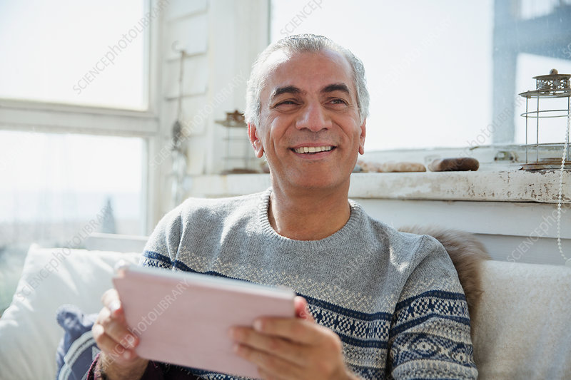 Portrait senior man using digital tablet