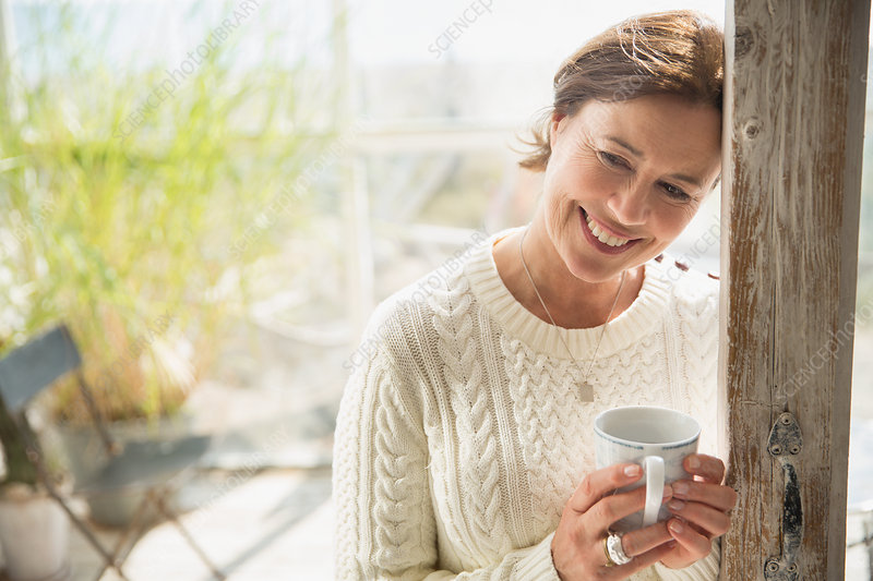 Portrait mature woman drinking coffee