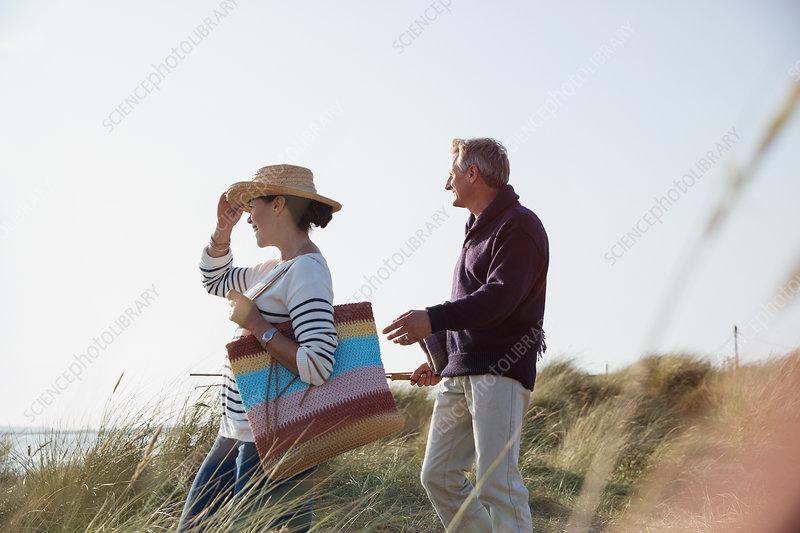 Mature couple walking grass path