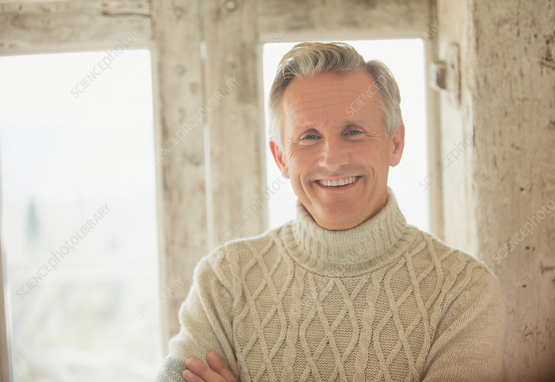 Portrait senior man in turtleneck sweater