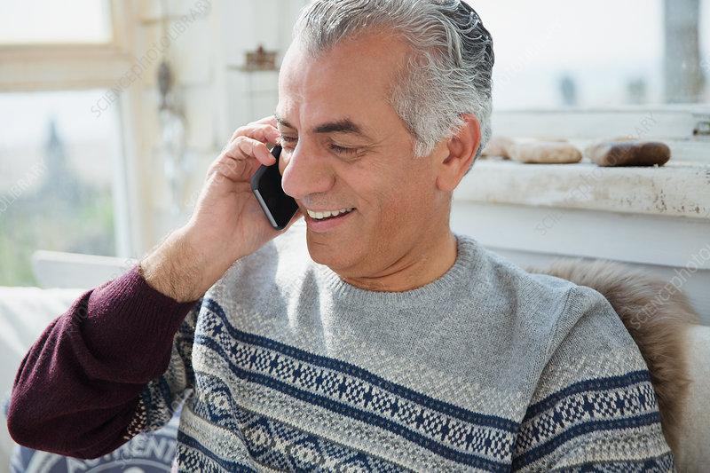 Senior man talking on cell phone