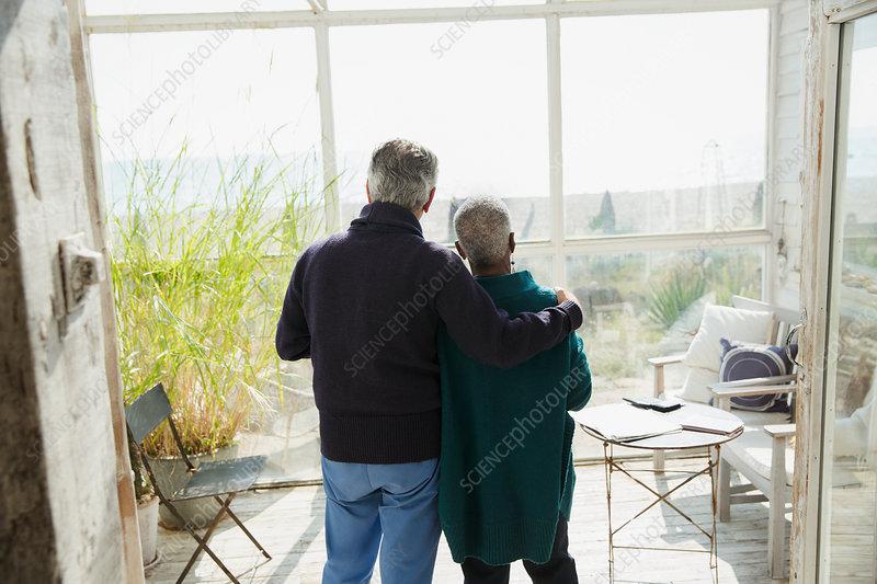Affectionate senior couple enjoying beach view